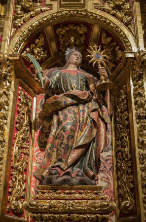 martyrdom: CUENCA, SPAIN - August 24, 2016: Interior of the Cathedral of Cuenca, St. Barbaras Chapel, situated behind the main Chapel and open to the ambulatory at the side of the Gospel, carved polychrome from the central niche of Santa Barbara, with its attribute Editorial