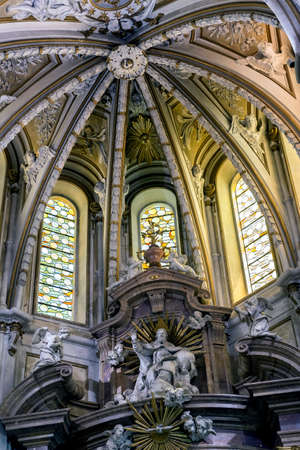 CUENCA, SPAIN - August 24, 2016: Interior of the cathedral of Cuenca, detail of Major Chapel or High altar Closed by three grills, Constructed in marble of carrara and jasper, the marble was worn out for Blas de Renteria, the sculptures and reliefs of the Editorial
