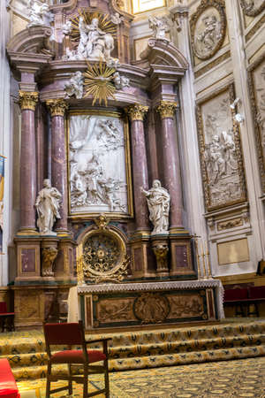 high altar: CUENCA, SPAIN - August 24, 2016: Interior of the cathedral of Cuenca, Major Chapel or High altar Closed by three grills, Constructed in marble of carrara and jasper, the marble was worn out for Blas de Renteria, the sculptures and reliefs of the altar are