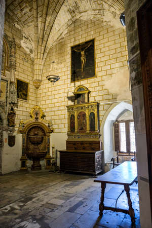 gothic window: CUENCA, SPAIN - August 24, 2016: Interior of the Cathedral of Cuenca, sacristy entrance of the higher sacristy, the Auld mug in the center left an altar, and on the right a Gothic window, Cuenca, heritage of humanity, Spain
