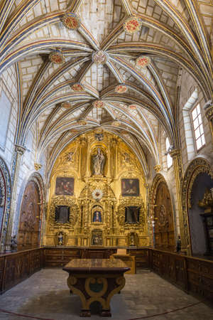 CUENCA, SPAIN - August 24, 2016: The Main Sacristy of the Cathedral of Cuenca, style of transition from the Gothic to the Plateresque. This is a stay rectangular with ribbed vaults profusely decorated. The Bureau of the center is made of marble with panel
