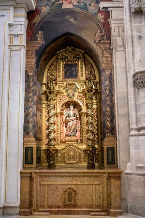 vangelo aperto: CUENCA, SPAIN - August 24, 2016: Interior of the Cathedral of Cuenca, St. Barbaras Chapel, situated behind the main Chapel and open to the ambulatory at the side of the Gospel, carved polychrome from the central niche of Santa Barbara, with its attribute Editoriali