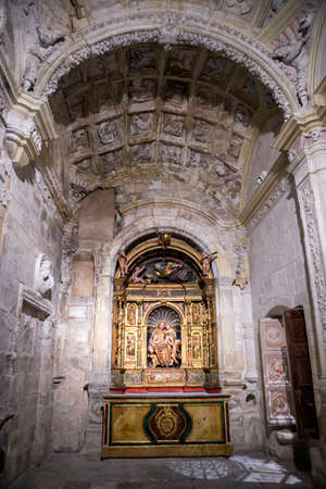 plateresque: CUENCA, SPAIN - August 24, 2016: Interior of the cathedral of Cuenca, Chapel Muñoz, founded by the Canon of the Cathedral Dr. Eustaquio Muñoz, altarpiece plateresque of Juan de Alarcón of the middle of the XVIth century, Cuenca, Patrimony of the humani