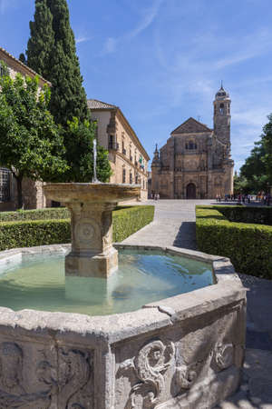 Ubeda, Spain - September 18, 2016: The Sacred Chapel of El Salvador (Capilla del Salvador) in the Plaza de Vazquez de Molina with the Parador hotel to the left, Ubeda, Jaen Province, Andalusia, Spain, Western Europe