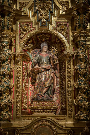 polychrome: CUENCA, SPAIN - August 24, 2016: Interior of the Cathedral of Cuenca, St. Barbaras Chapel, situated behind the main Chapel and open to the ambulatory at the side of the Gospel, carved polychrome from the central niche of Santa Barbara, with its attribute Editorial