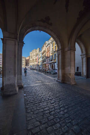 cuenca: CUENCA, SPAIN - August 24, 2016: An arch leading to Plaza Mayor in Cuenca, Spain Editorial