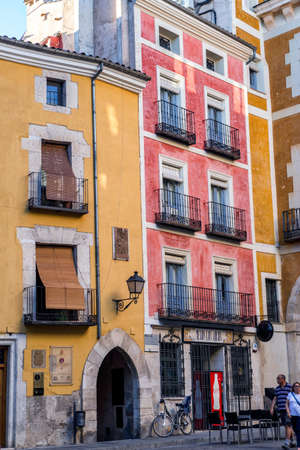 southern european: typical houses construction in the old town of the city of Cuenca, fronts painted with living colors, Cuenca, Spain