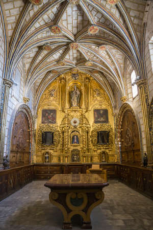 plateresque: CUENCA, SPAIN - August 24, 2016: The Main Sacristy of the Cathedral of Cuenca, style of transition from the Gothic to the Plateresque. This is a stay rectangular with ribbed vaults profusely decorated. The Bureau of the center is made of marble with panel