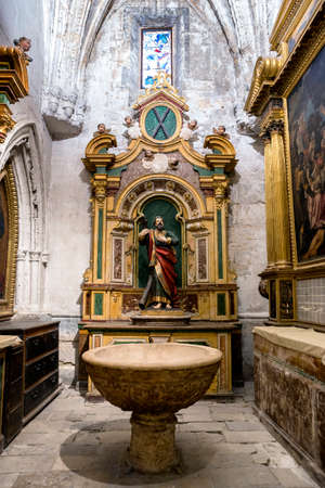 baptismal: CUENCA, SPAIN - August 24, 2016: Interior of the Cathedral of Cuenca, baptismal Chapel, also called Chapel of San Antolin or Cabrera, is the oldest of the Cathedral built in century XIV, the central figure is San Ignacio, Cuenca, heritage of humanity, Spa Editorial