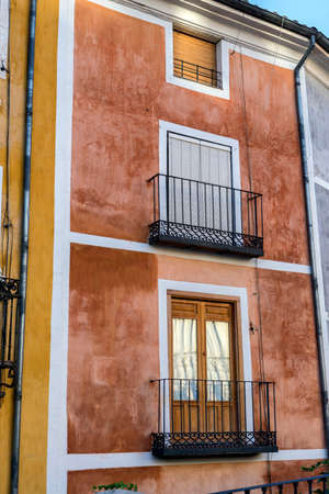 southern european: typical construction of houses in the old part of the city of Cuenca, detail of reflection of Cathedral in crystals on balcony, Cuenca, Spain Stock Photo