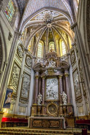 CUENCA, SPAIN - August 24, 2016: Interior of the cathedral of Cuenca, Major Chapel or High altar Closed by three grills, Constructed in marble of carrara and jasper, the marble was worn out for Blas de Renteria, the sculptures and reliefs of the altar are