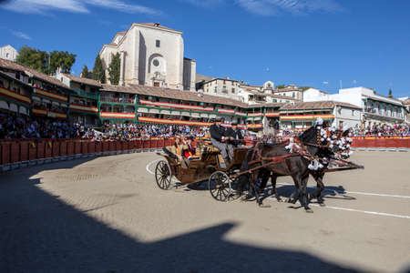 horse cart: Chinchon, Spain - October 15, 2016: Traditional bullfighting stamp, Horse Cart with the maids of honor of the bull events in the plaza mayor of chinchon during the festival benefit, Chinchon, Madrid province, Spain