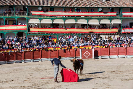 Chinchon, SPAIN - October 15, 2016: Spainish bullfighter El Fundi with the cape in the main square of chinchon during the festival benefit traditional, Chinchon, Madrid province, Spain