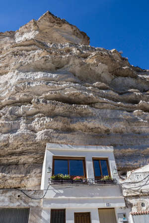 fortitude: Alcala del Jucar, Spain - October 29, 2016: Cave House in the mountains of limestone, next to the banks of the river Jucar, take in Alcala of the Jucar, Albacete province, Spain