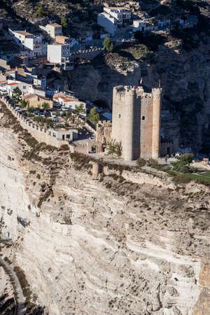 fortitude: Alcala del Jucar, Spain - October 29, 2016: Panoramic view of the city, on top of limestone mountain is situated Castle of the 12TH century Almohad origin, take in Alcala of the Jucar, Albacete province, Spain