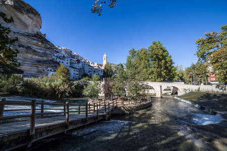 fortitude: Alcala del Jucar, Spain - October 29, 2016: Recreation area on the River Jucar, beautiful mountain views limestone next to the city, take in Alcala of the Jucar, Albacete province, Spain