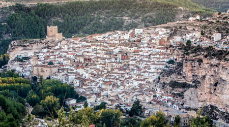 building wall: Alcala del Jucar, Spain - October 29, 2016: Panoramic view of the city, on top of limestone mountain is situated Castle of the 12TH century Almohad origin, take in Alcala of the Jucar, Albacete province, Spain