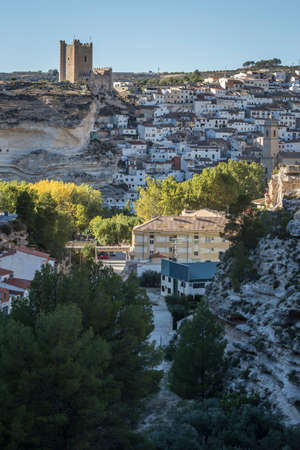 fortitude: Alcala del Jucar, Spain - October 29, 2016: Side view of the village, on top of limestone mountain is situated Castle of the 12TH century Almohad origin, take in Alcala of the Jucar, Albacete province, Spain