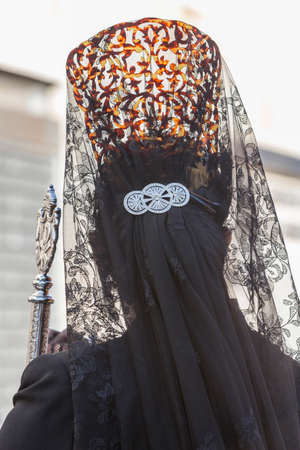 Woman dressed in mantilla during a procession of holy week, Spain 版權商用圖片