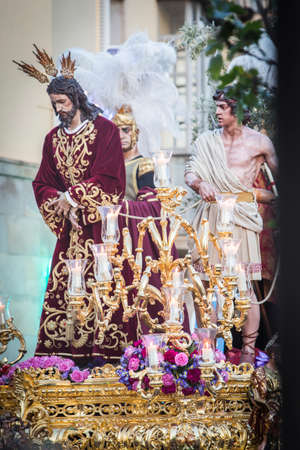 Brotherhood of Jesus corsage making station of penitence in front at the town hall, Linares, Jaen province, Andalusia, Spain Stock Photo