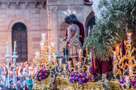 Brotherhood of Jesus corsage making station of penitence in front at the town hall, Linares, Jaen province, Andalusia, Spain Editorial