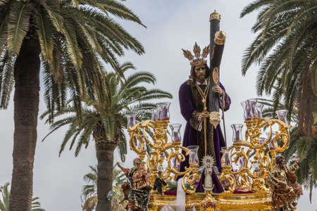 Jesus of Nazareth carrying wooden cross, Throne more popular in this city, represents jesus bearing the cross to Mount Calvary to be crucified, Linares, Andalusia, Spain