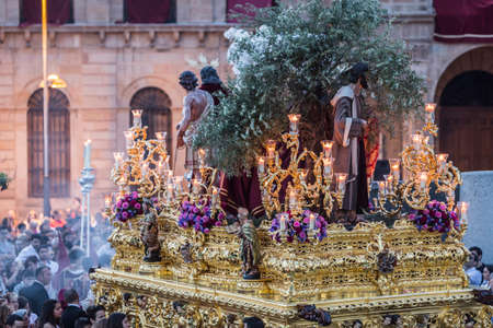 penitence: Brotherhood of Jesus corsage making station of penitence in front at the town hall, Linares, Jaen province, Andalusia, Spain Stock Photo