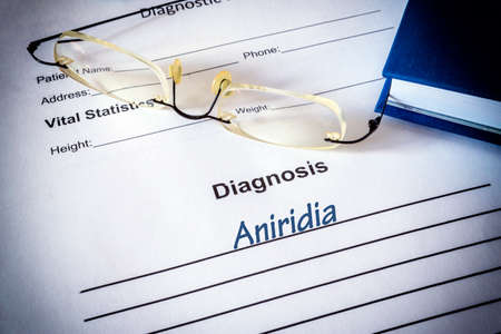 Diagnosis list with aniridia. Eye disorder concept.