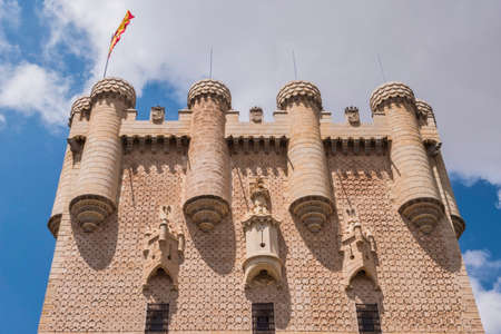 Segovia, SPAIN - June 3: Partial view of the Castle from the entrance to the monument and drawbridge, Juan II Tower, rising out on a rocky crag, built in 1120, Segovia, Castilla y Leon, Spain Editorial