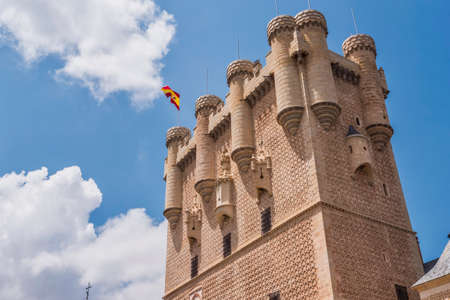 Segovia, SPAIN - June 3: Partial view of the Castle from the entrance to the monument and drawbridge, Juan II Tower, rising out on a rocky crag, built in 1120, Segovia, Castilla y Leon, Spain Stock Photo