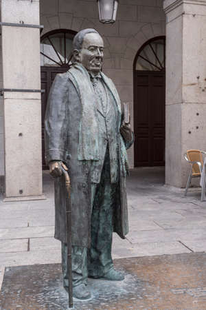 SEGOVIA, SPAIN - June 3, 2017: Statue in honor of the Spanish poet Antonio Machado in the main square of Segovia, Spain Editorial