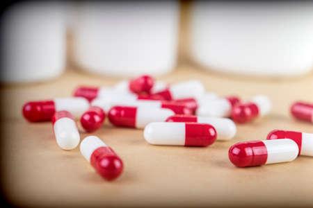 Pills spilling from an open bottle Stock Photo