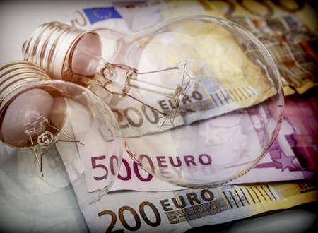 A lightbulb on euro bill, energy saving concept 版權商用圖片