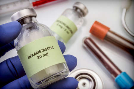 Doctor hold vial of dexamethasone in a hospital. Conceptual image