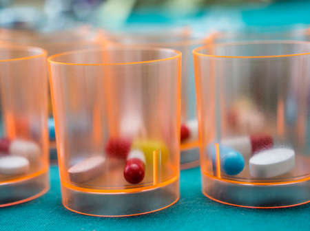 Daily medication at a hospital table, conceptual image Stock Photo