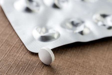 Blister with white pills, conceptual image