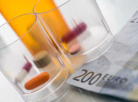 Some blisters of white pills on tickets for 200 euros, conceptual image copaid health