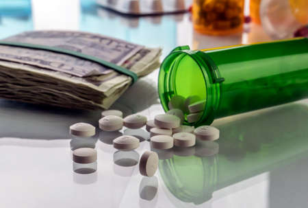 Some medications on a ticket of dollar, conceptual image copay health Stock Photo