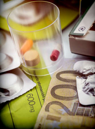 Some medicines along with a ticket of 200 euros, conceptual image copay health