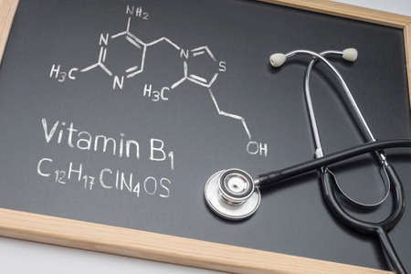 Chemical formula of vitamin B1 drawn on a whiteboard together with a stethoscope, conceptual image Reklamní fotografie