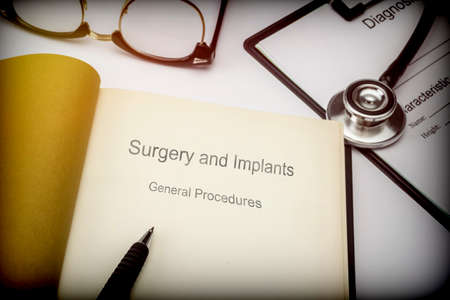 Titled book Surgery and implants general procedures along with medical equipment, conceptual image