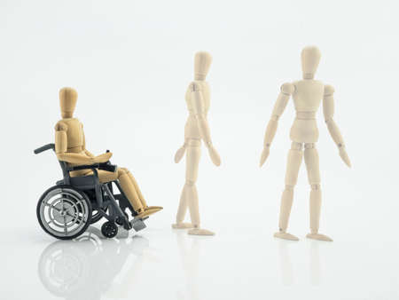 Wooden doll in wheelchair, steps for rehabilitation, conceptual image Stockfoto