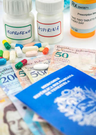 Medicines next to banknotes of Venezuela, shady deal of medication in full crisis of country of Latin America, conceptual image 写真素材