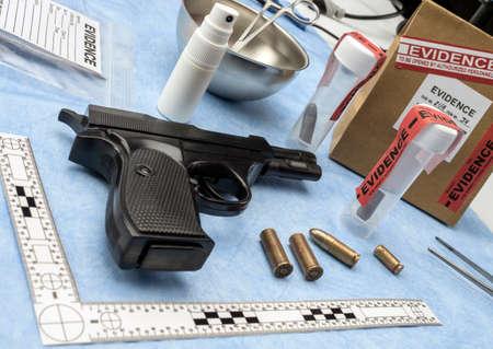 Criminalistic Laboratory, Firearm next to bullet cap for ballistic analysis, conceptual image