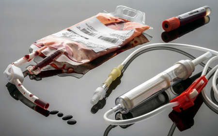 Empty blood Bag next to dropper, conceptual image Archivio Fotografico