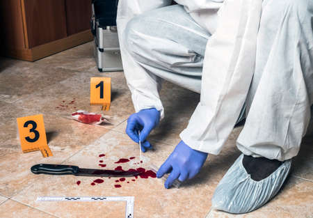Expert Police takes blood sample from a blood knife at the scene of a crime, conceptual image Stock fotó - 121438525