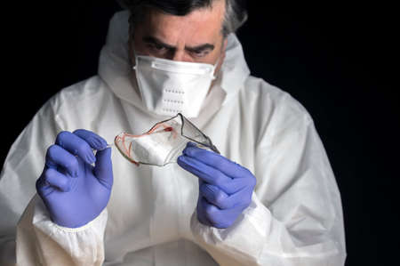 Police expert gets blood sample from a broken glass bottle in Criminalistic Lab, conceptual image