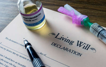 Living will declaration form Next to a vial of pentobarbital sodium to proceed to euthanasia, conceptual image Archivio Fotografico