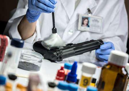 Police Scientific extracts traces of a gun in the laboratory of balistica, conceptual image