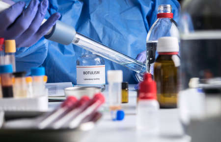 Specialist analyzes botulism Samples in laboratory, conceptual image Imagens
